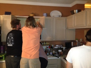 Picture of guys installing microwave
